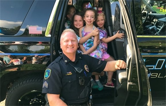 Night to Unite Officer with Children in Police Cruiser
