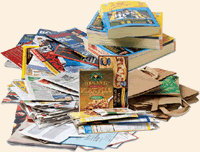 An assorted collection of paper, including magazines and mail.