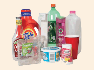 An assorted collection of plastics, including a milk carton and soft drink bottle.