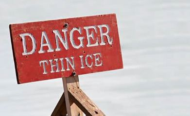 Danger Thin Ice sign in snow