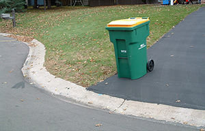 Garbage Can Placed Behind the Curb on Driveway-garbagecanplacement-news-300