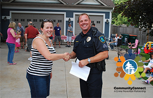 Officer shaking residents hand - CommunityConnect, A Crime Prevention Partnership