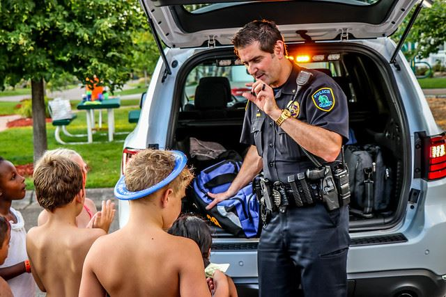 Chief with Children Behind Police Vehicle