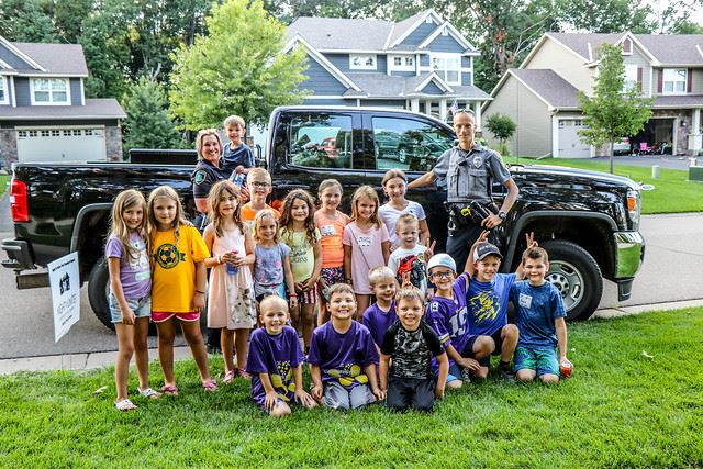 Police Officers with Neighborhood Children Group Shot