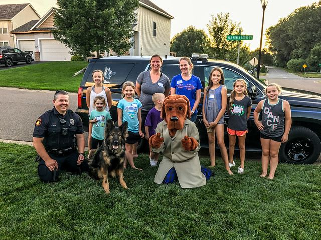 Officer, K9, and McGruff with Neighborhood Children Group Shot