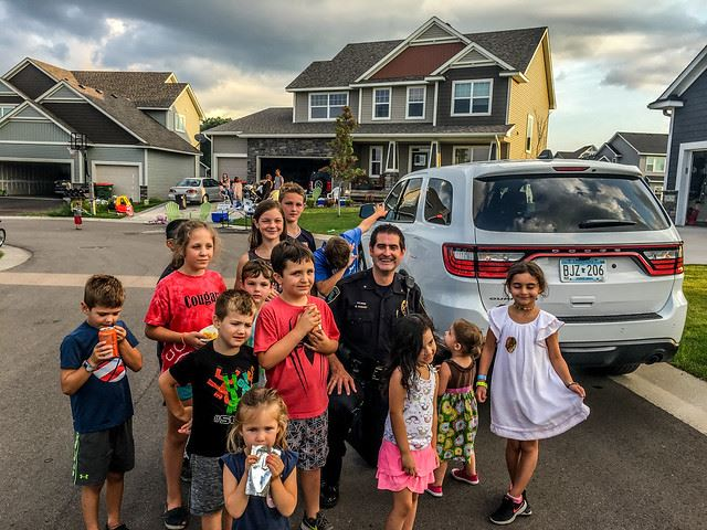 Chief with Neighborhood Children in Front of Police Vehicle