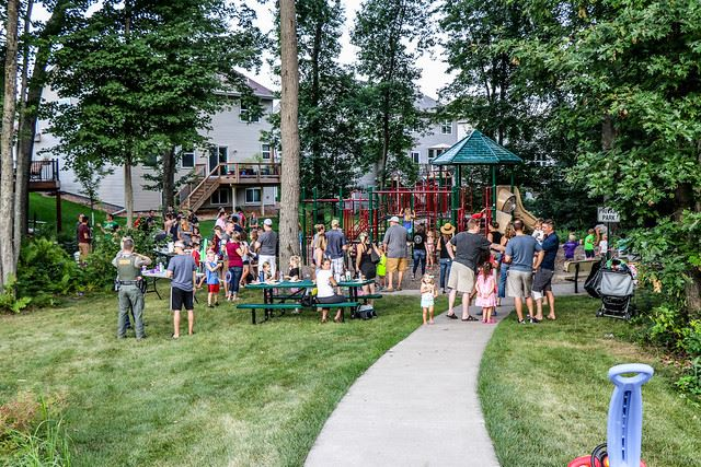 Neighborhood Party in Park with Trees