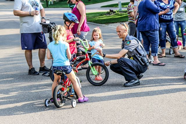 Officer with Children on Bikes